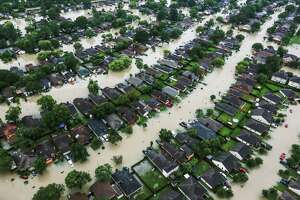 A neighborhood is inundated by floodwaters from Harvey near east Interstate 10 on Aug. 29 in Houston. ( Brett Coomer / Houston Chronicle )