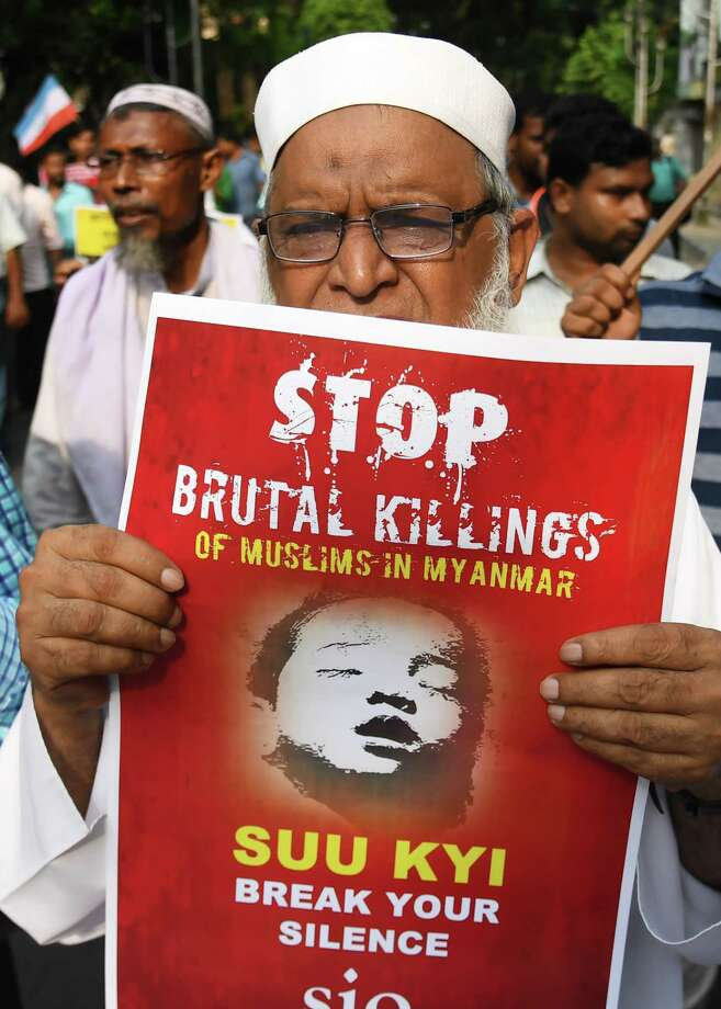 An Indian Mushlim holds a placard during a rally against the Myanmar government to protest the treatment of Rohingya Muslims in Kolkata Thursday. Myanmar has been criticized over the plight of the Rohingya Muslims. Photo: DIBYANGSHU SARKAR, Contributor / AFP or licensors