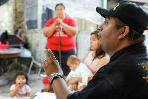 Community organizer Alain Cisneros talks to Rockport Apartment residents about the damage to their homes following Tropical Storm Harvey on Thursday, Sept. 7, 2017, in Houston. Many had to pay September's rent, even as their apartments are unlivable.