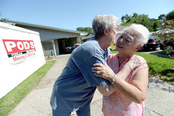 Myrtle Williamson gets a goodbye hug from Sandra Gann, who was among a group of volunteer helpers from Houston that helped clear her flood damaged home on 41st St. in Port Arthur Thursday. The group were not impacted by Houston's floods and volunteered their efforts to assist those in need throughout Southeast Texas.  Photo taken Thursday, September 7, 2017 Kim Brent/The Enterprise