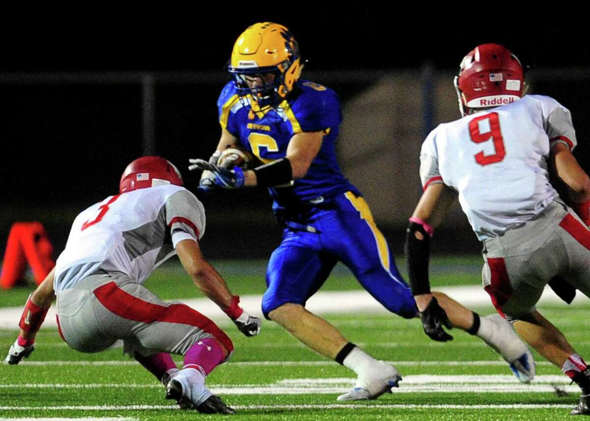 Seymour's Bobby Melms carries the ball during football action against Wolcott in Seymour, Conn. on Friday Oct. 7, 2016.