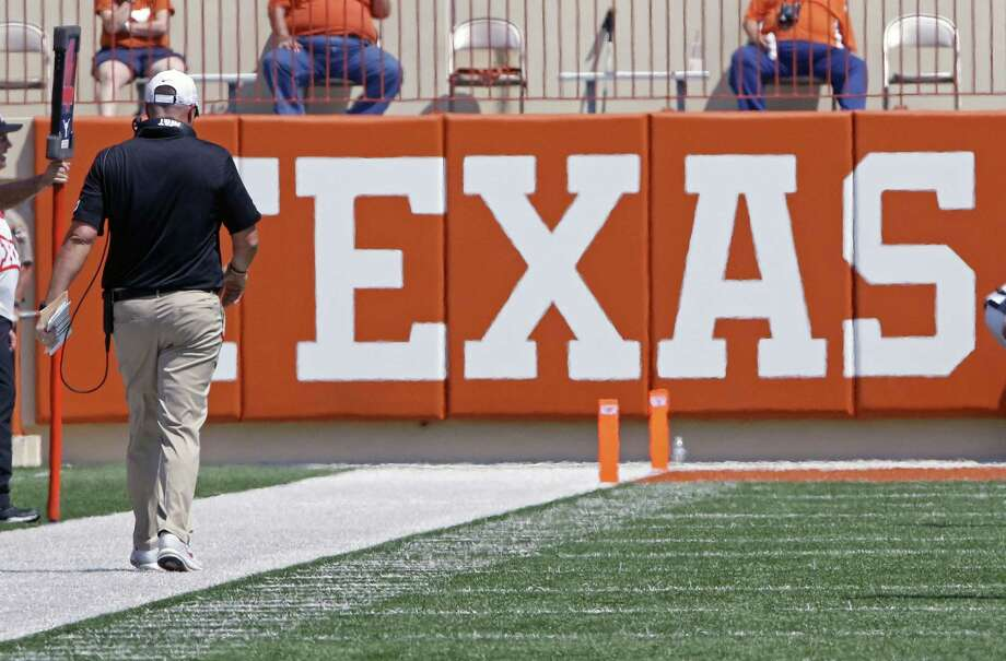 Texas coach Tom Herman walks the sideline during the first half of a 51-41 loss to Maryland, in Austin, on Sept. 2, 2017. Photo: Michael Thomas /Associated Press / FR65778 AP