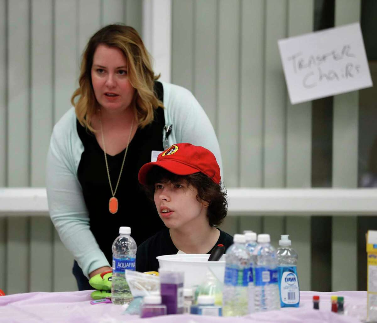 Kristen McClintock, of Westside High School, works with her student Emily Foust, 21 at a makeshift day school at the West Gray Multiservice Center, Wednesday, Sept. 6, 2017, in Houston. As schools remain closed for a second straight week in most Houston-area districts, a group of Houston ISD teachers have created pop-up childcare centers and day camps across the city. About 1,600 certified teachers have signed up to help hundreds of local students in local shelters, in churches and in any space they can find. They said they worried about parents being over-loaded dealing with flooded homes on top of trying to find someone to care for their children.