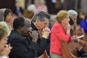 Archbishop Gustavo García-Siller prays during the Holy Hour of Prayer for Harvey's victims Thursday evening at St. Matthew Church. Bishops from throughout the state called for parishes to observe the hour of prayer and ring the church bells at 7 p.m.