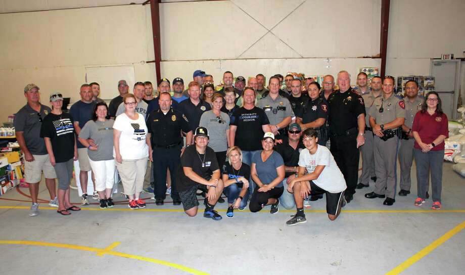 Law enforcement officers from multiple agencies in East Montgomery County were treated to a whole assortment of household goods provided by Behind the Line and Back the Blue, two pro-law enforcement organizations from Baton Rouge, La. The departments gathered for a jambalaya meal provided by the Baton Rouge organizations on Thursday, Sept. 7, in Roman Forest. Then officers were allowed to pick the items they need for their homes. Photo: Vanesa Brashier