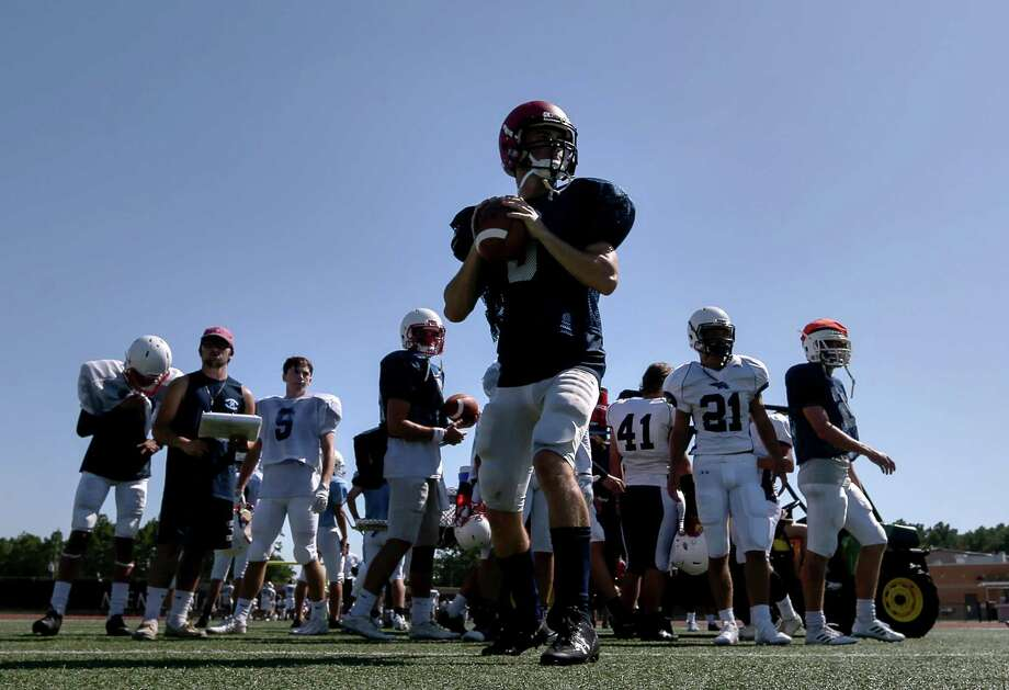 Matt Slayton, center, drops back to pass during practice at Turner Stadium on Thursday. Despite losing its school to flooding, the Kingwood football team is carrying on thanks to the help of many other schools. Photo: Jon Shapley, Staff / © 2017 Houston Chronicle