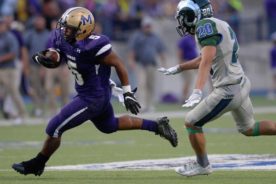 Midland High running back Tim Gates (5) gets past El Paso Montwood's Gabino Cortez III (20) on a touchdown run Sept. 7, 2017, at Grande Communications Stadium. James Durbin/Reporter-Telegram Photo: James Durbin