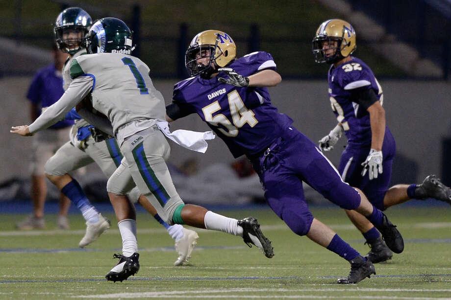 Midland High's Marshall Mayfield (54) attempts to sack El Paso Montwood quarterback Andrew Fernandez (1) Sept. 7, 2017, at Grande Communications Stadium. James Durbin/Reporter-Telegram Photo: James Durbin