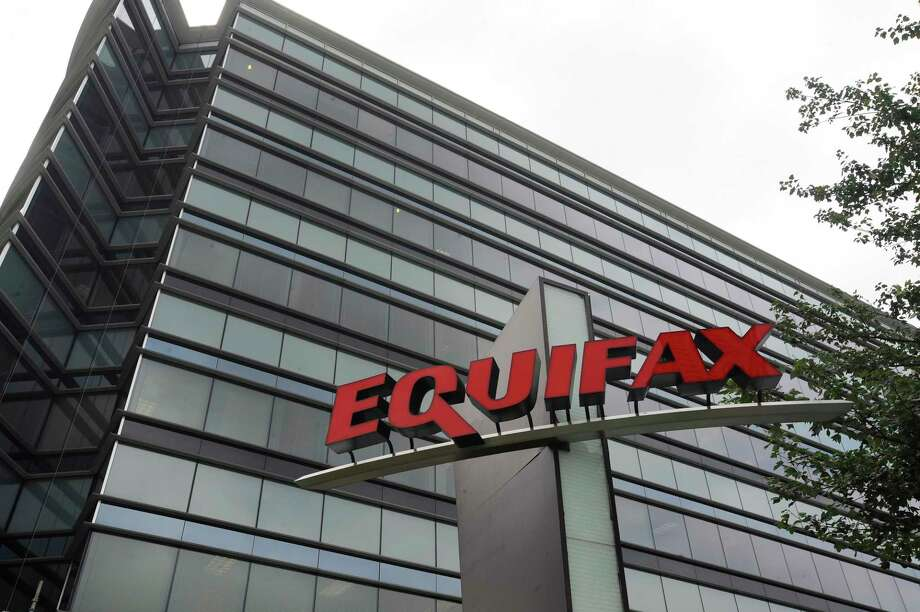 """This July 21, 2012, photo shows Equifax Inc., offices in Atlanta. Credit monitoring company Equifax says a breach exposed social security numbers and other data from about 143 million Americans. The Atlanta-based company said Thursday, Sept. 7, 2017, that """"criminals"""" exploited a U.S. website application to access files between mid-May and July of this year. (AP Photo/Mike Stewart) Photo: Mike Stewart, STF / Copyright 2017 The Associated Press. All rights reserved."""