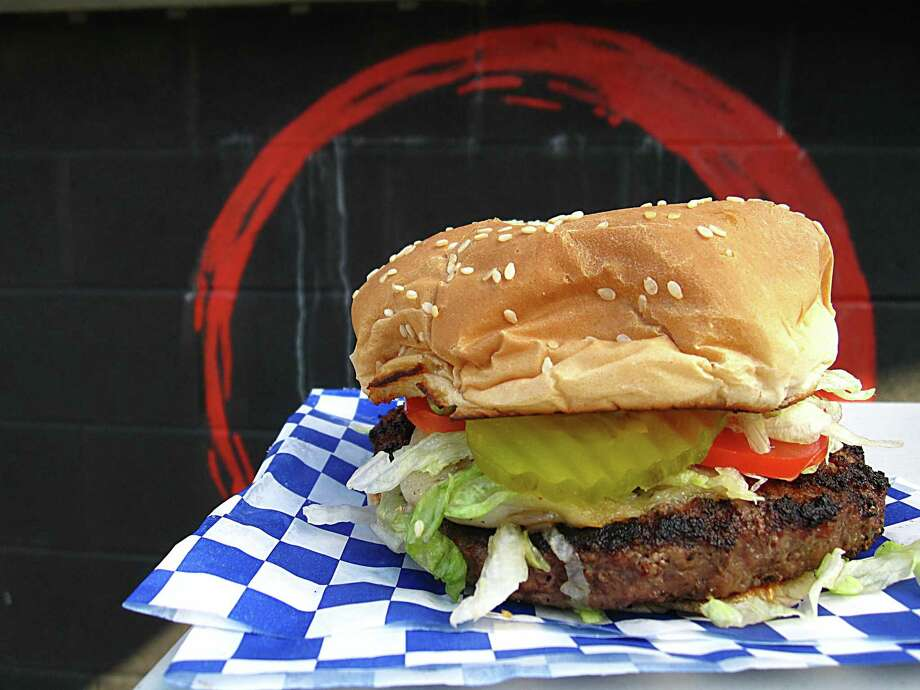 A half-pound ground chuck burger on a sesame seed bun from Burger Culture. Photo: Mike Sutter /San Antonio Express-News