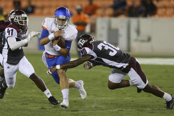 Houston Baptist Huskies quarterback Bailey Zappe (11) carries the ball while Texas Southern Tigers linebacker Demontario Anderson (41) and defensive back Archie Rice (30) are trying to stop him during the second quarter of the game at BBVA Compass Stadium Thursday, Sept. 7, 2017, in Houston. ( Yi-Chin Lee / Houston Chronicle )