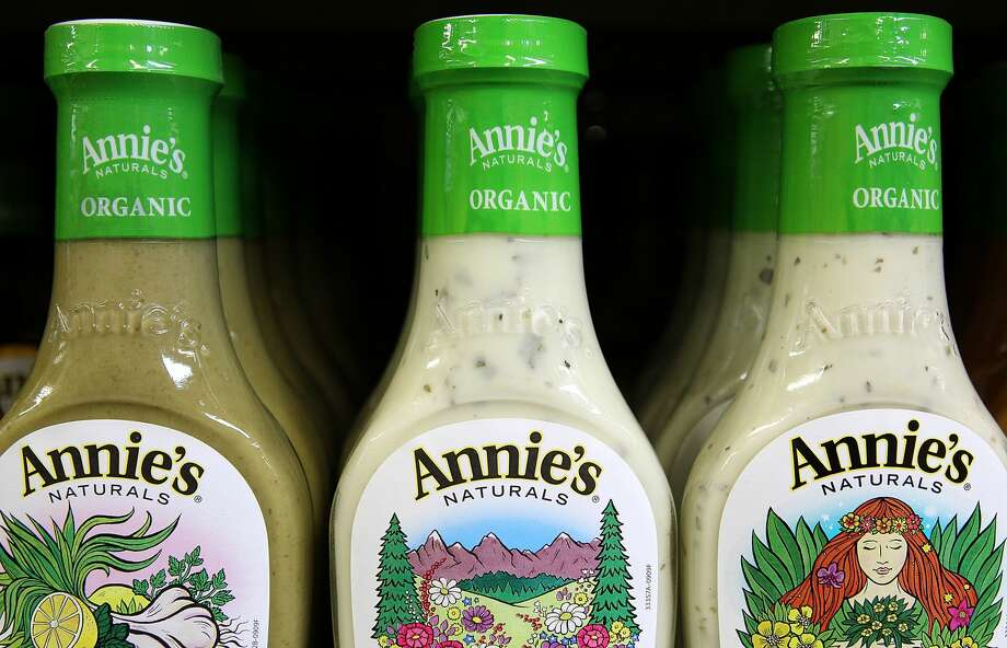 "BERKELEY, CA - MARCH 28:  Bottles of Annie's Naturals salad dressing are seen displayed on a shelf at Berkeley Bowl on March 28, 2012 in Berkeley, California. Two consumers have filed a class-action lawsuit against Annie's Homegrown for falsely labeling its salad dressings as ""natural."" Photo: Justin Sullivan/Getty Images"