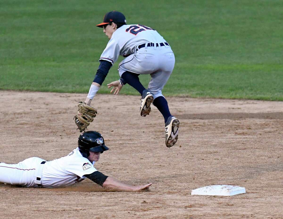 Tri-City ValleyCats' Jake Meyers (8) slides safely under Connecticut Tigers shortstop Cole Peterson (20) beating a pick off attempt at second base during a minor league baseball game on Thursday, Sept. 7, 2017, in Troy, N.Y. (Hans Pennink / Special to the Times Union) ORG XMIT: HP118