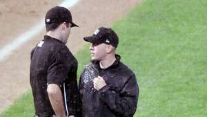 Officals talk before stoping play between the Tri-City ValleyCats and the Connecticut Tigers as a heavy rainstorm starts during a minor league baseball game on Thursday, Sept. 7, 2017, in Troy, N.Y. (Hans Pennink / Special to the Times Union)  ORG XMIT: HP130