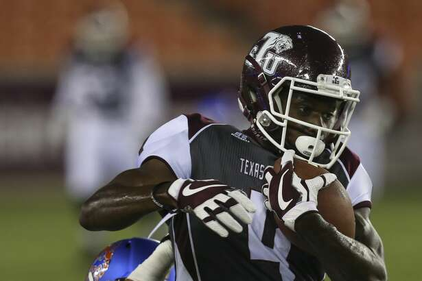 Texas Southern Tigers wide receiver Darvin Kidsy (4) completes a pass and is fouled by Houston Baptist Huskies safety Taylor Thompson (24) during the first quarter of the game at BBVA Compass Stadium Thursday, Sept. 7, 2017, in Houston. ( Yi-Chin Lee / Houston Chronicle )