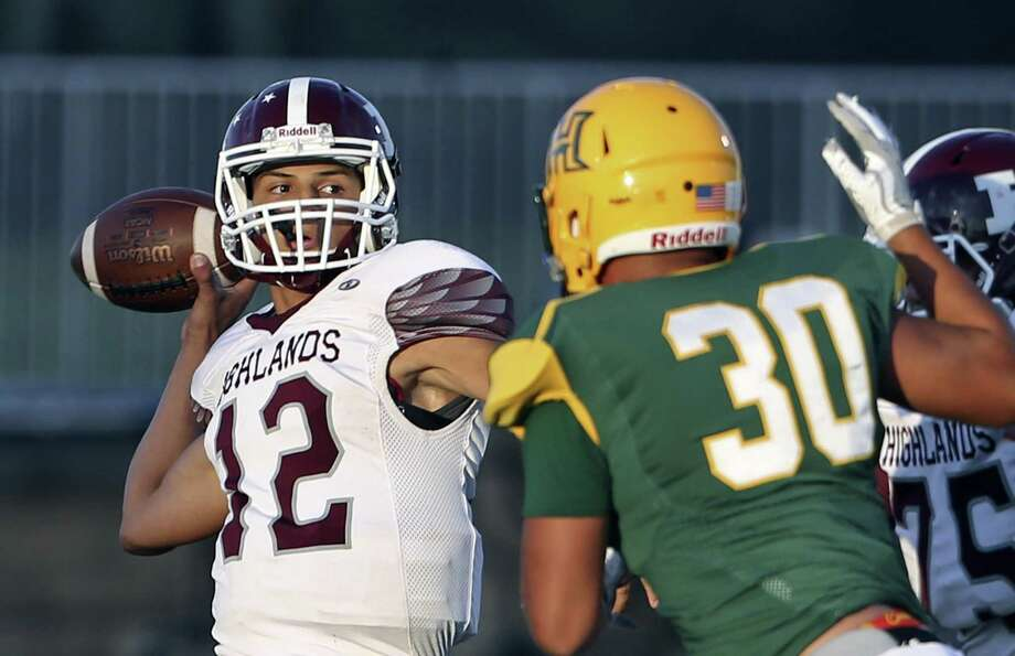 Owls quarterback Joseph Palafos spots a receiver as Holmes hosts Highlands at Gustafson Stadium on Sept. 7. Photo: Tom Reel /San Antonio Express-News / 2017 SAN ANTONIO EXPRESS-NEWS