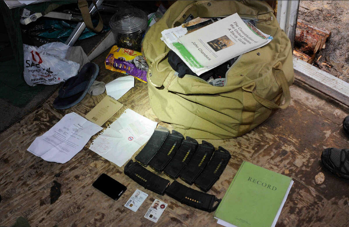 Books and equipment seized by investigators during an investigation into Cliven Bundy bodyguard Schuyler Barbeau is pictured in a law enforcement image.