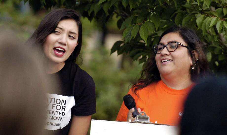 From left, Angelica Idrovo of Danbury, a 21-year-old student at UCONN Stamford and Wendy Cardenas of Stamford, a Parent Organizer with Building One Community lead hundreds of activists from Fairfield County communities gathered in Mill River Park, across from Trump Parc Stamford in Stamford, Connecticut on Tuesday, Sept. 5, 2017, in protest to President Donald Trump decision on the future of Deferred Action for Childhood Arrivals (DACA). Without DACA, 800,000 immigrant youth and their families who have made this country their home will their protection from deportation. Photo: Matthew Brown / Hearst Connecticut Media / Stamford Advocate