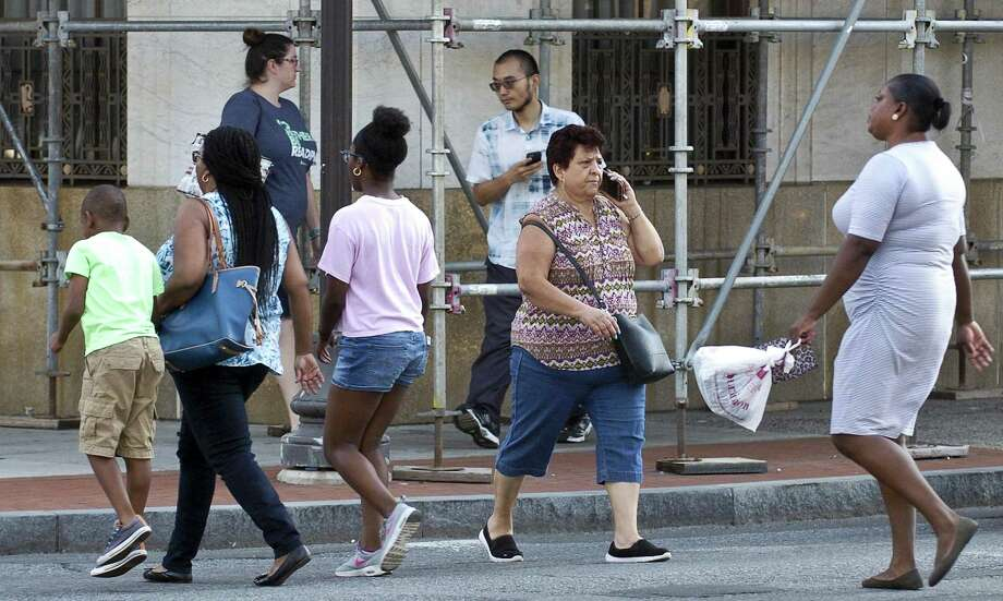 A women talks on her cell phone as she crosses Broad Street on Wednesday, August 16, 2017  in Stamford, Connecticut. Photo: Matthew Brown / Hearst Connecticut Media / Stamford Advocate