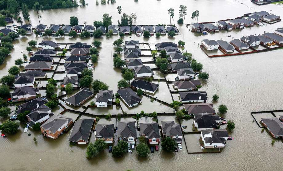 A neighborhood is inundated by floodwaters from Tropical Storm Harvey on Tuesday, Aug. 29, 2017, in Spring. ( Brett Coomer / Houston Chronicle ) Photo: Brett Coomer, Staff / © 2017 Houston Chronicle