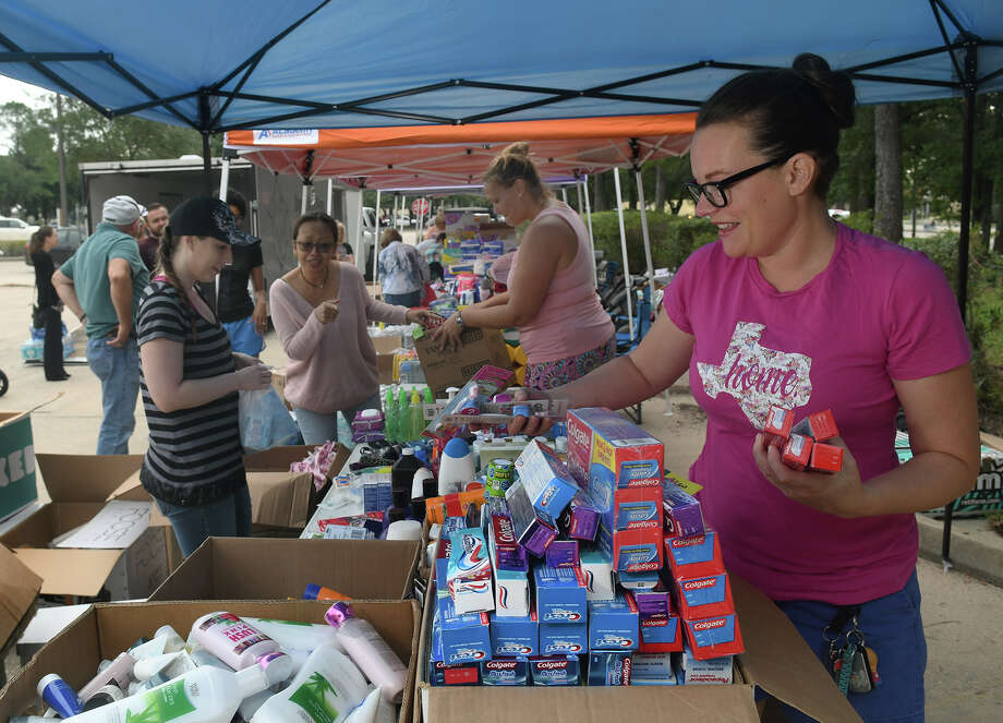 Volunteer Cristi Lengefeld, from left, helps Sari Overman pick supplies while her fellow volunteers Ally Mansfield and Claire Brom sort the donations from Phoenix, Az., delivered by Arizona businessmen Deon Nikolic and Stewart Meadows to be distributed to people in need in the parking lot at the intersection of Kingwood Drive and West Lake Houston Parkway in Kingwood on Sept. 6, 2017. (Photo by Jerry Baker/Freelance) Photo: Jerry Baker, Freelance / Freelance