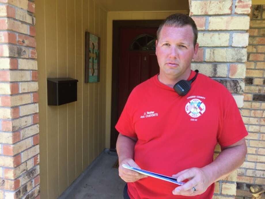 Joshua Taylor, a first responder with the Port Arthur Fire Department, stands outside his home on his first day off since Aug. 24.