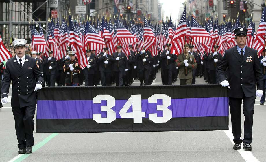 Firefighters carrying 343 American flags representing the firefighters who died during the terrorist attacks on the World Trade Center march up Fifth Avenue during the St. Patrick's Day parade in New York in 2012. Photo: Mary Altaffer, AP