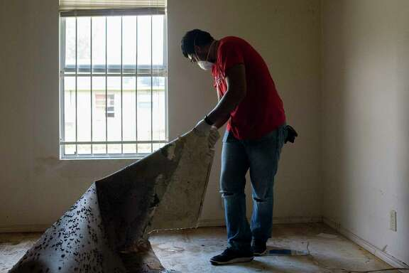 Adrian Galindo cleans up a home in the Kashmere Gardens neighborhood of Houston, Sept. 2, 2017. A week after Texas was slammed by Hurricane Harvey, this region was still engulfed in crisis on Saturday, with weary residents of Houston searching for ways to repair swamped homes and salvage possessions. (Bryan Thomas/The New York Times)
