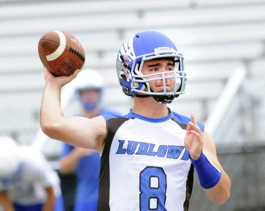 Fairfield Ludlowe quarterback Josh Evans throws during a Grip It & Rip It football tournament back in July. New coach Mitch Ross takes over for the Falcons, who went 0-10 last season. Photo: Bob Luckey Jr. / Hearst Connecticut Media / Greenwich Time