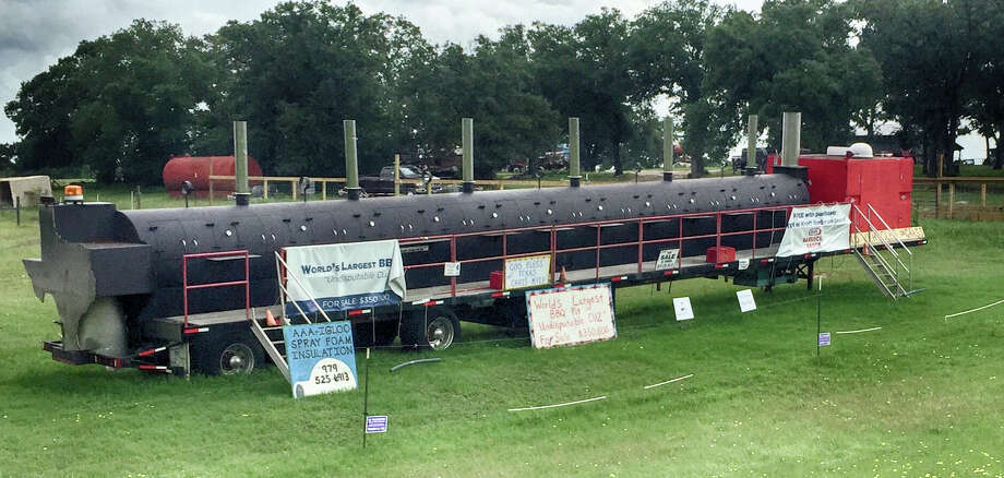 Kimberly King and Terry Folsom's 24-door BBQ pit can cook about 8,000 pounds of meat simultaneously. The rig is said to weigh about 40 tons. Photo: Courtesy Of Houston Automobile Dealers Association
