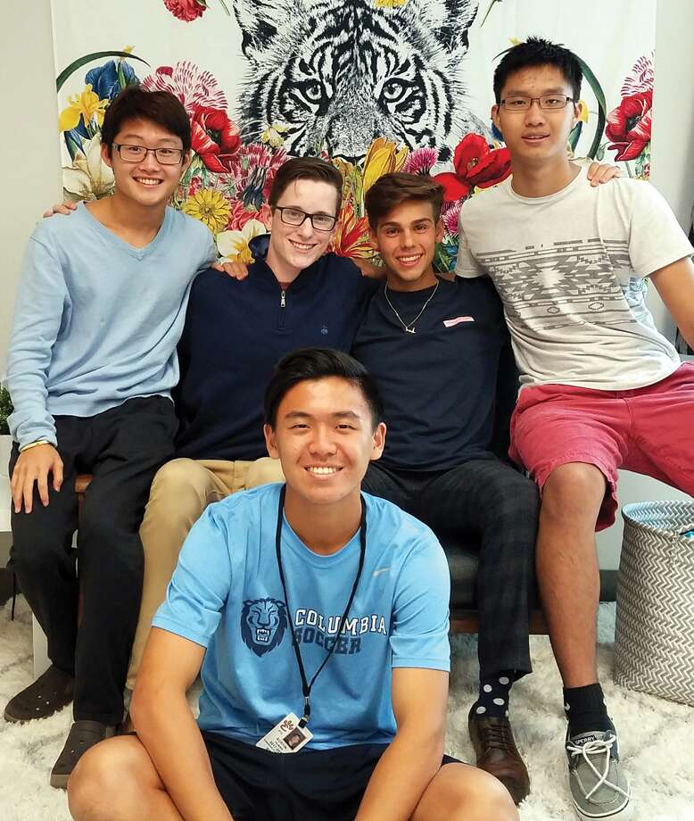 Edwardsville High School Senior Class members helping organize a fundraiser for Hurricane Harvey relief are, in back, from le Joshua Myung, Stephen Stewart, Joe Paulucci, Alex Wang. Austin Huang is seated on the floor. Photo: Carol Arnett • Carnett.edwi@gmail.com