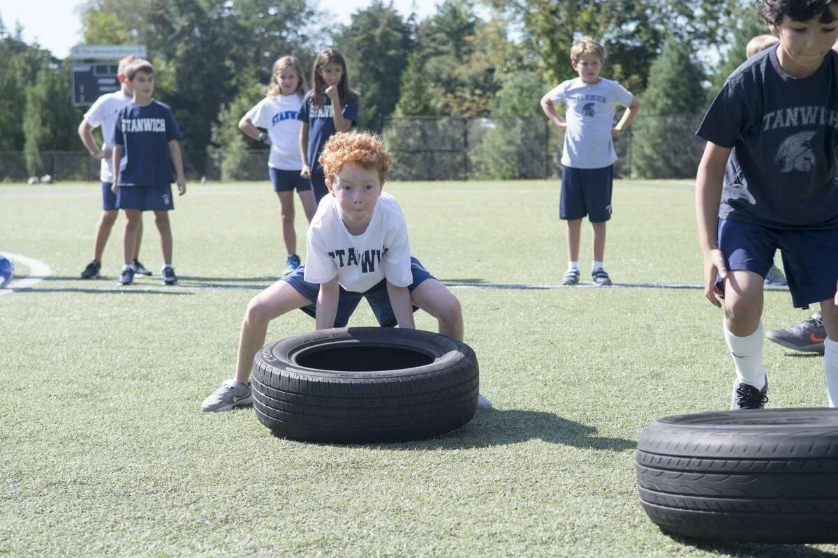 The famous grueling Spartan Race professionals hosted a special work out for kids at the Stanwich School Sept. 8, 2017. Stanwich students from Kindergarten through Grade 5 participated in running, sweating, climbing, and crawling their way through training drills for the upcoming Spartan Kids Race that takes place in Stamford on September 23-24. Stanwich is the exclusive school sponsor of the Spartan Kids Race.