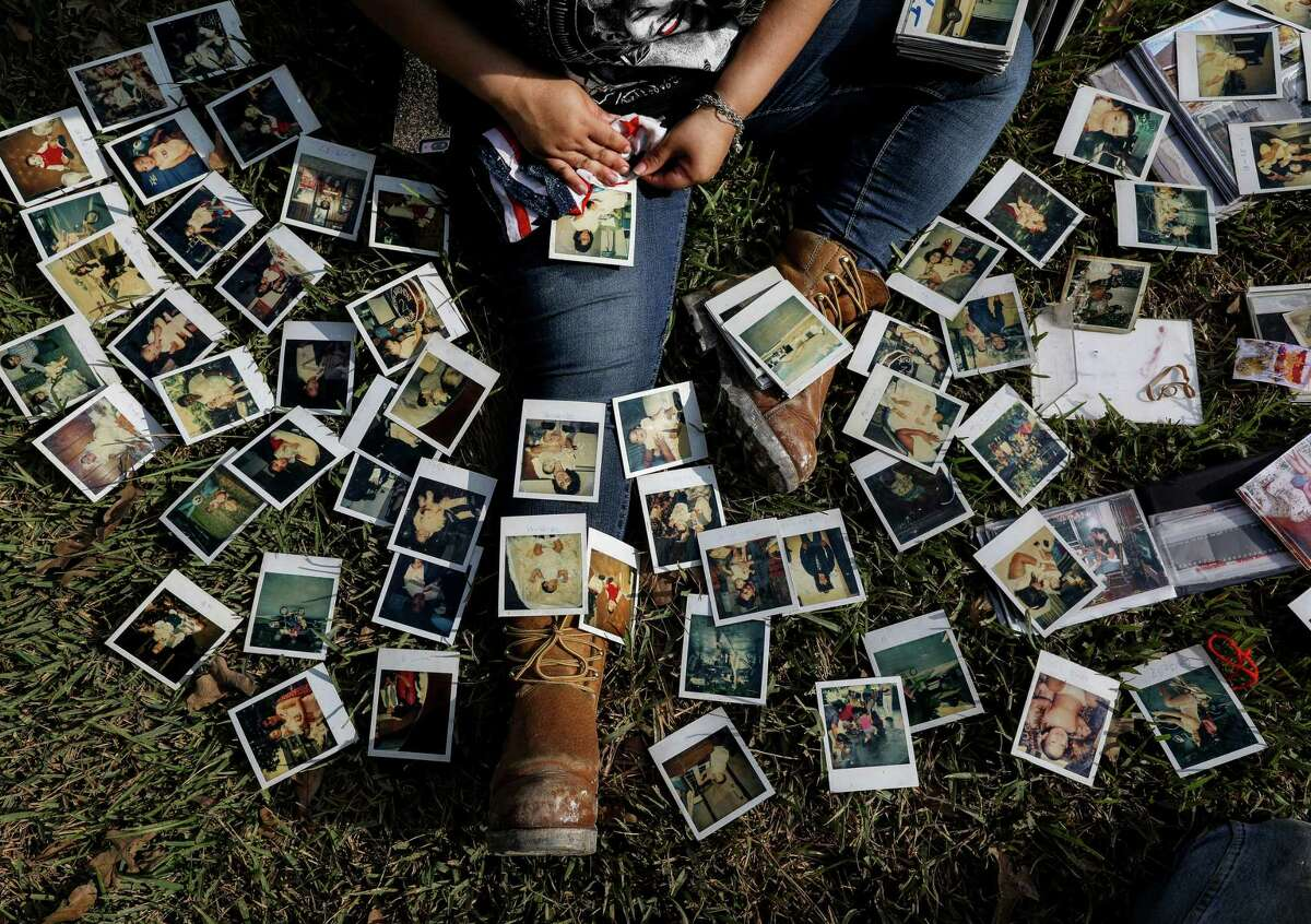 Rikki Saldivar goes through old family photos at a house that belonged to her grandparents, Tuesday, Sept. 5, 2017, in Houston. Saldivar's grandparents, and four young relatives, drowned in a van in Greens Bayou during Hurricane Harvey.