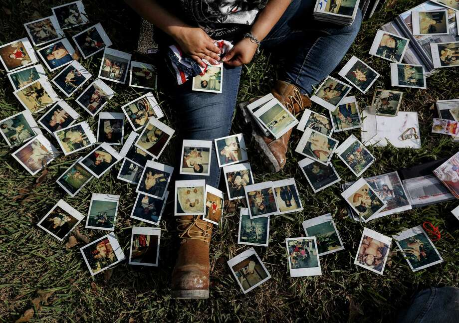 Rikki Saldivar goes through old family photos at a house that belonged to her grandparents, Tuesday, Sept. 5, 2017, in Houston. Saldivar's grandparents, and four young relatives, drowned in a van in Greens Bayou during Hurricane Harvey. Photo: Jon Shapley, Houston Chronicle / © 2017 Houston Chronicle