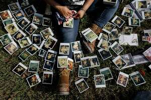 Rikki Saldivar goes through old family photos at a house that belonged to her grandparents, Tuesday, Sept. 5, 2017, in Houston. Saldivar's grandparents, and four young relatives, drowned in a van in Greens Bayou during Tropical Storm Harvey.