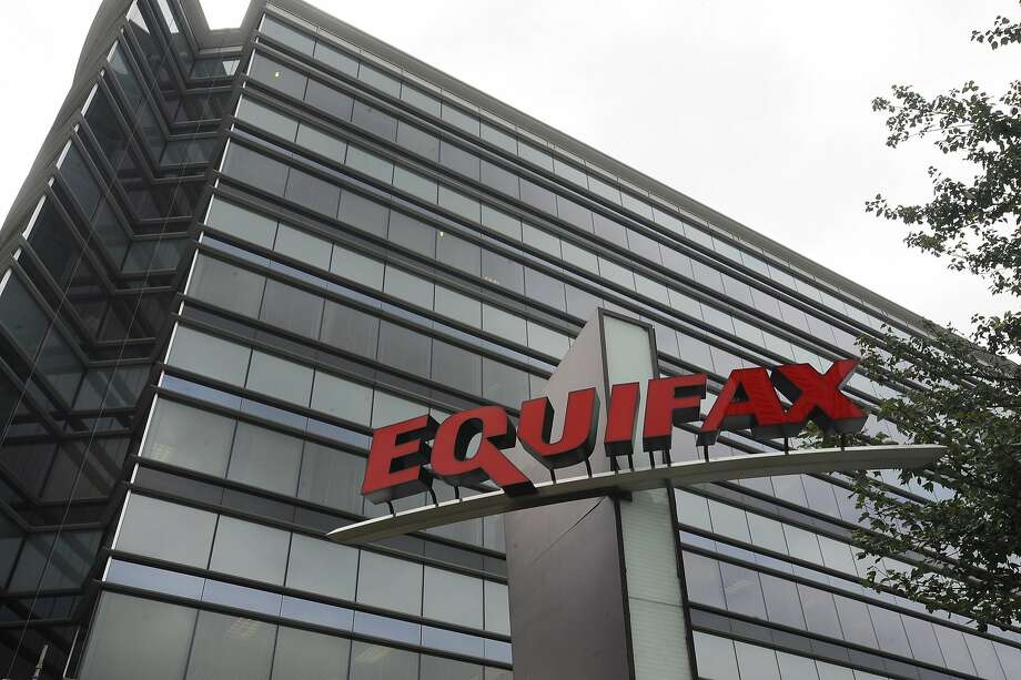"""This July 21, 2012, photo shows Equifax Inc., offices in Atlanta. Credit monitoring company Equifax says a breach exposed social security numbers and other data from about 143 million Americans. The Atlanta-based company said Thursday, Sept. 7, 2017, that """"criminals"""" exploited a U.S. website application to access files between mid-May and July of this year. (AP Photo/Mike Stewart) Photo: Mike Stewart, Associated Press"""