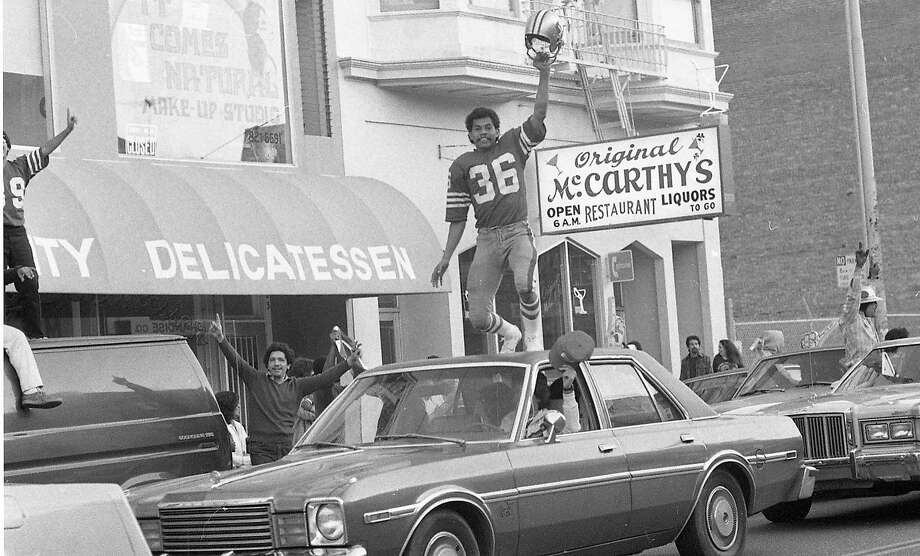 San Francisco 49ers fans party in the Mission District after the team's Super Bowl XVI victory. Jan. 24, 1982. Photo: John O'Hara, The Chronicle