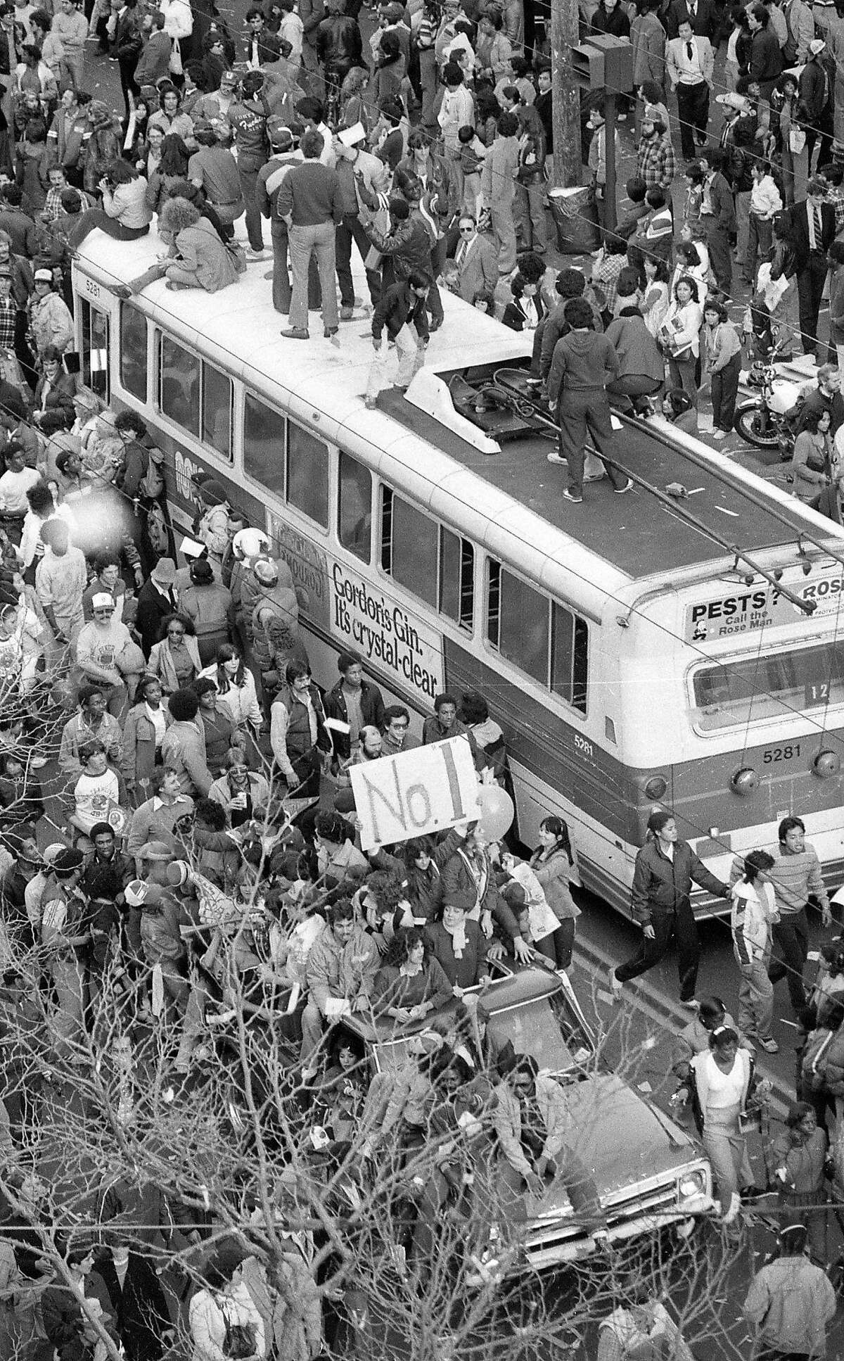 Fans celebrate the 49ers Super Bowl XVI win by climbing on top of a Muni bus. Jan. 25, 1982.