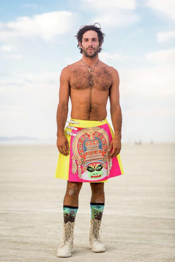 Alex Regenstreich from Venice Beach wearing a Manish Arora Kilt at Burning Man 2017. Photo: Sidney Erthal / Burning Man