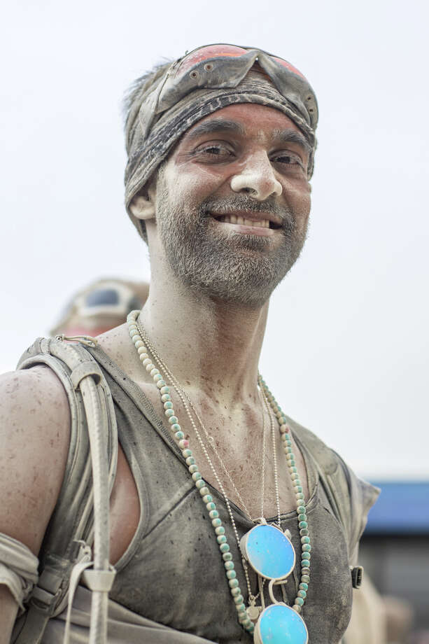 A participant covered with playa dust at Burning Man 2017. Photo: Sidney Erthal / Burning Man
