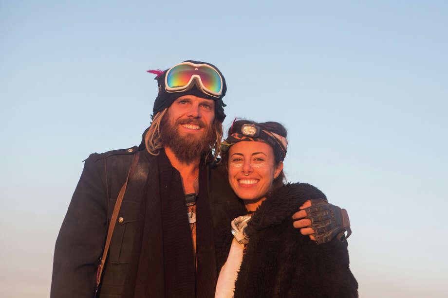 A couple at sunrise at Burning Man 2017. Photo: Sidney Erthal / Burning Man
