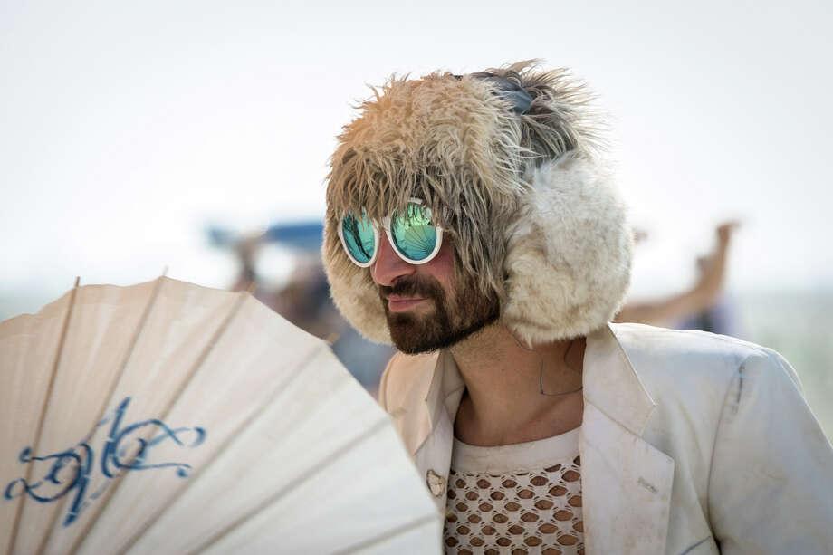 A participant dancing at Burning Man 2017. Photo: Sidney Erthal / Burning Man