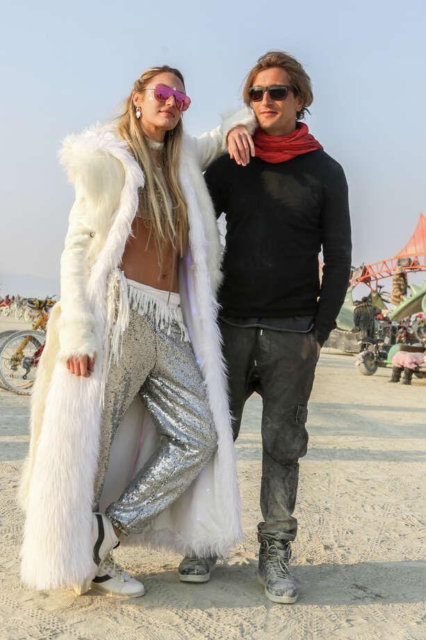 South African top model Candice Swanepoel and husband Herman Nicoli at Burning Man 2017. Photo: Sidney Erthal / Burning Man