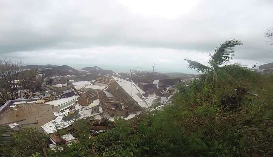 This image made from video shows several damaged houses by Hurricane Irma in St. Thomas, U.S. Virgin Islands, Thursday, Sept. 7, 2017. Hurricane Irma weakened slightly Thursday with sustained winds of 175 mph, according to the National Hurricane Center. The storm boasted 185 mph winds for a more than 24-hour period, making it the strongest storm ever recorded in the Atlantic Ocean. The storm was expected to arrive in Cuba by Friday. It could hit the Florida mainland by late Saturday, according to hurricane center models. Photo: Ian Brown, AP / Copyright 2017 The Associated Press. All rights reserved.