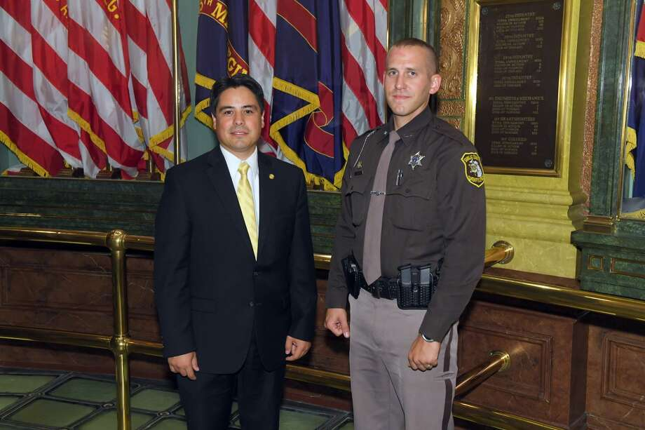 State Rep. Shane Hernandez, of Port Huron, was recently joined by Sanilac County Sheriff's Deputy and U.S. Coast Guard veteran Luke Zeller as his guest for the Michigan House's annual Sept. 11 Memorial Service at the Capitol. The ceremony remembers first responders and members of the military from Michigan who died in the line of duty in the past year. Photo: Submitted Photo