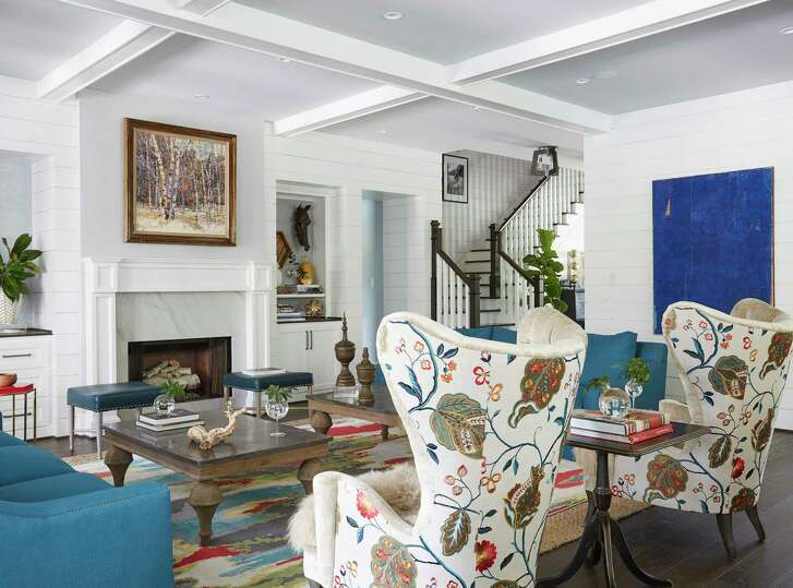 The family room in the 2017 Southern Living Showcase Home in the Bluejack National golf course community in Montgomery. Fabric on the back of armchairs in this family room served as inspiration for the entire house. The bold colors are repeated in nearly every room against white/light neutral walls.