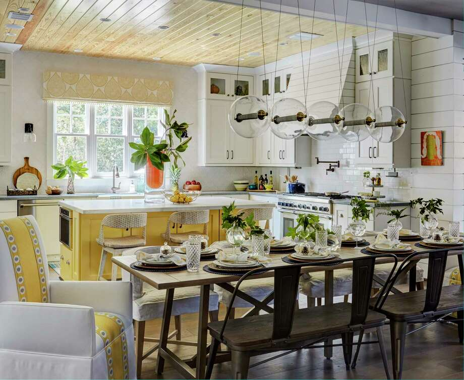 The kitchen in this home in the Bluejack National golf course community in Montgomery features white cabinets, a popular choice in kitchen remodeling projects. Photo: Mike Kaskel