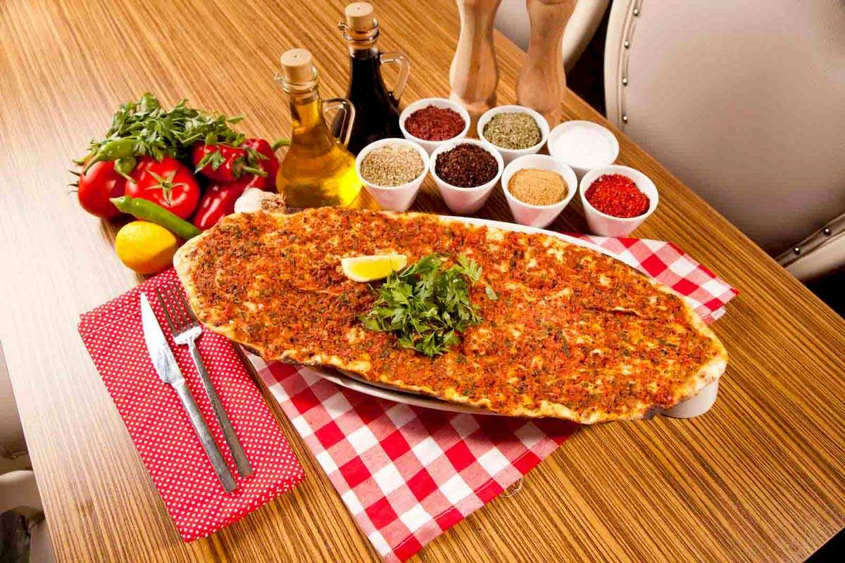 Lahmacun (Turkish Pizza) - Special marinated ground beef on a thin dough. Phone: (210) 736-2887 CLICK HERE!
