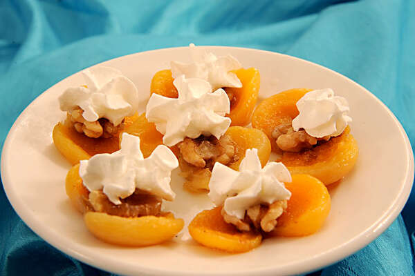 Kayisi Tatlisi  - Sundried apricots stuffed with walnuts and served with whipped cream. Phone: (210) 736-2887    CLICK HERE!