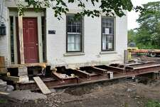 Meredith Anker's home at 4 Washington Avenue in the Stockade is being elevated and set back about 15 feet from Washington Avenue to remove it from the flood plain Tuesday Sept. 5, 2017 in Schenectady, NY.  (John Carl D'Annibale / Times Union)